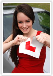 Female learner driving ripping up L plates after passing driving test the first time